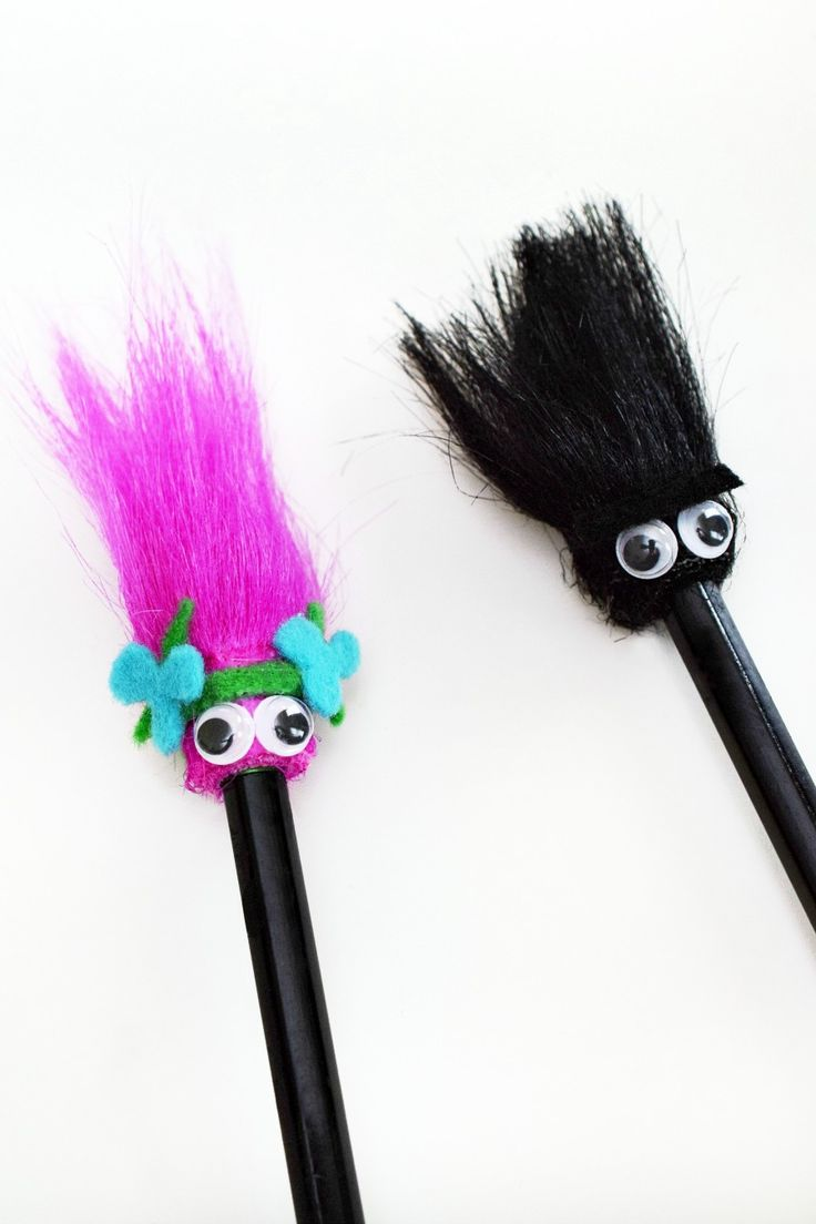 Make Trolls-inspired pencil toppers that look like Princess Poppy and Branch!
