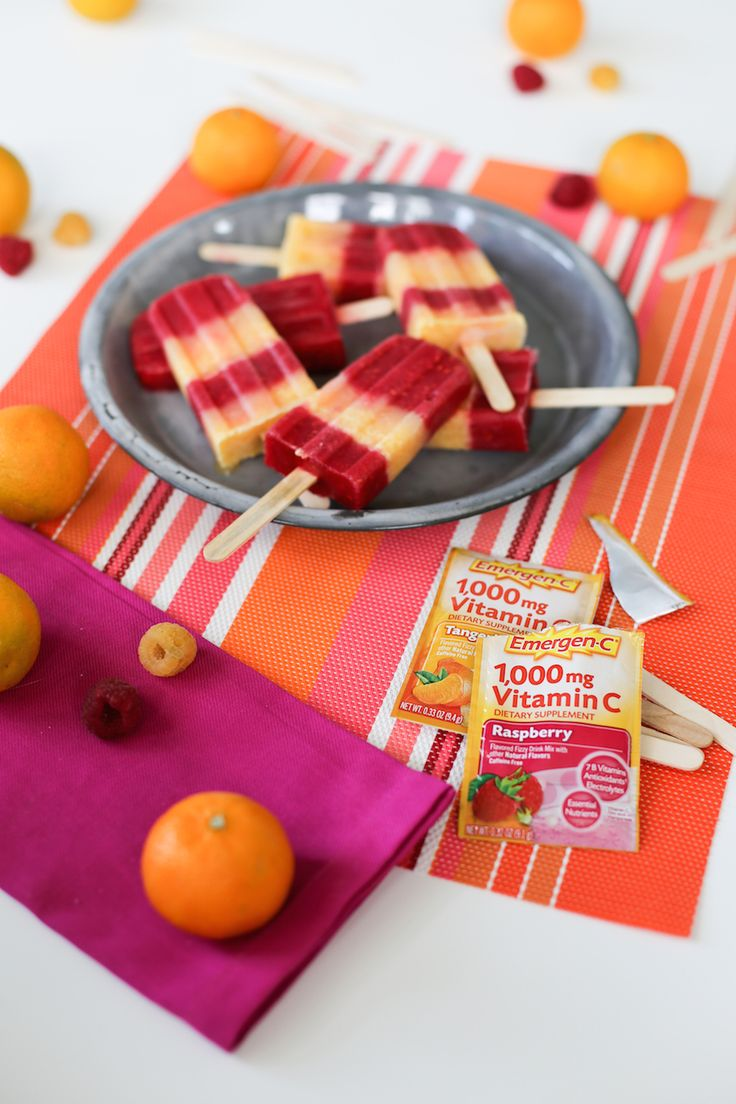 Cool off this summer with these Raspberry Tangerine Popsicles made with Emergen-C! // saltycanary.com // #ad #EmergenCRecipes @walmart