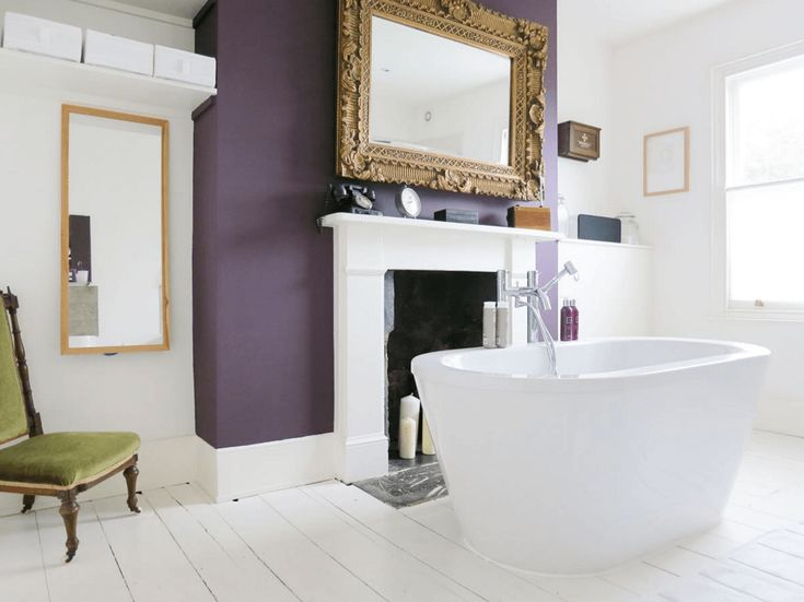 Deep Purple Accented Bathroom A bold purple accent wall completely transforms a blank canvas.