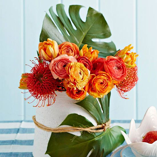 Disguise the not-so-cute vases by cutting large leaves and tying them to your vases with jute string.
