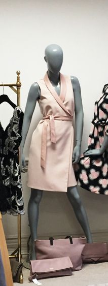 Wrap dress in pastel pink by Caroline Matthews