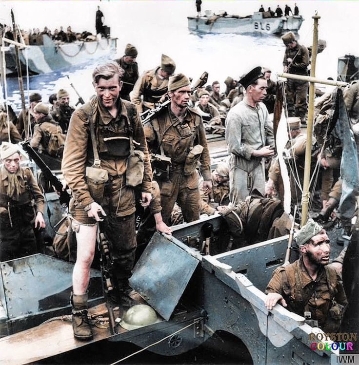 British commandos who took part in The Dieppe Raid 'Operation Jubilee' at Newhaven, South of England. 19 August 1942 The Soldier with the bandaged leg is Gunner Len Ruskin of 'B' Troop and the one wearing the German cap is Private E.L. Fraser of 'F' Troop both of Group 2, 4/Commando on their return in landing craft (LCAs) at Newhaven Harbour, East Sussex, England.