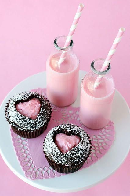 cute idea - make cupcake, punch out center with heart cookie cutter, dust with powdered sugar and fill heart with frosting