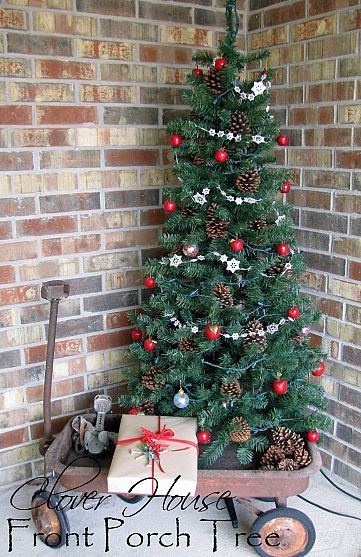 Front porch tree in a wagon. Tracy Hetrick, this would look perfect on your front stoop!