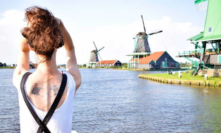 Zaanse Schans. Beautiful green little place with windmills and little houses. Great trip from Amsterdam