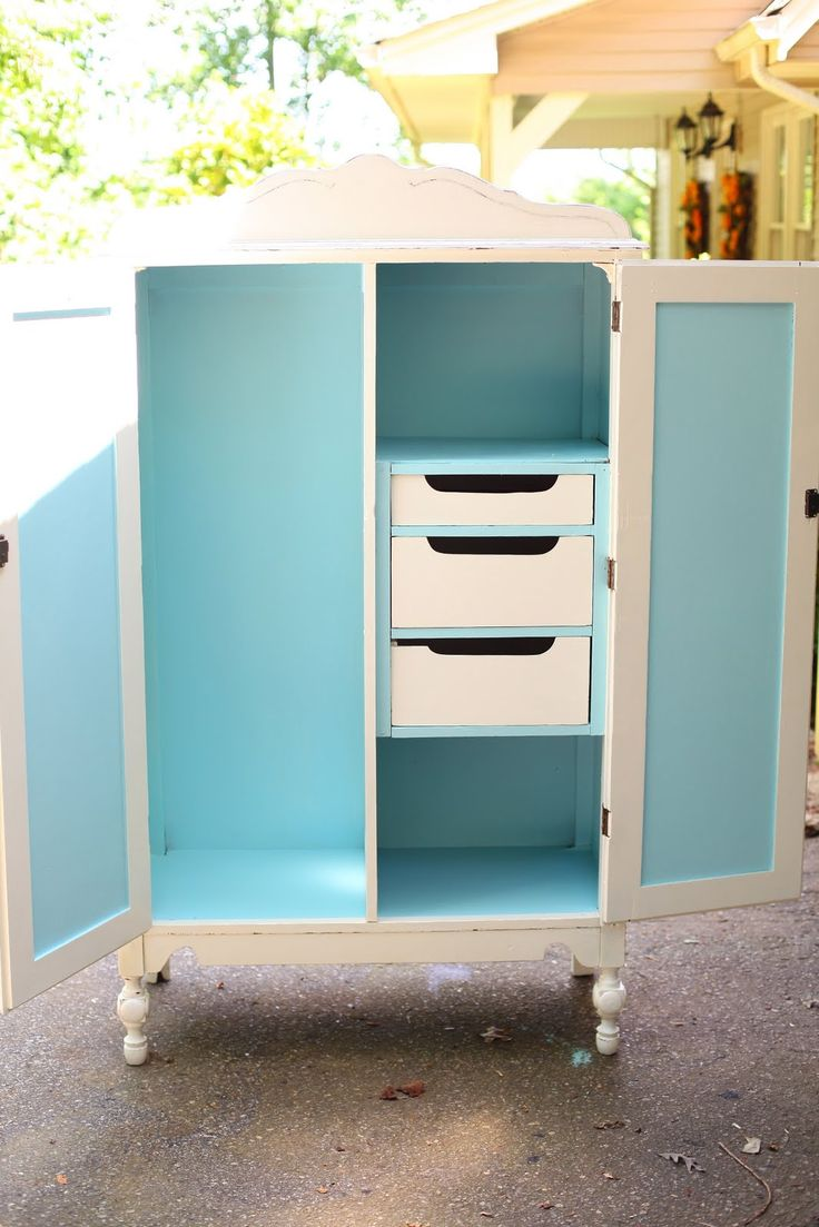 White Painted Wardrobe with lovely pop of blue inside. Don't know what it would be used for, but I like it.