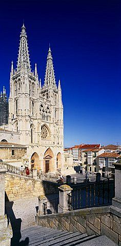 SPAIN Castilla Y Leon  Burgos Province Cathedral.  View from flight of stone steps in the foreground towards gothic facade and twin spires.