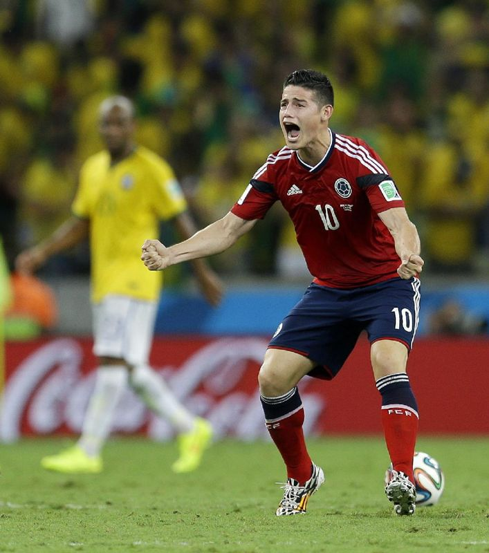 Colombia's James Rodriguez celebrates scoring his side's first goal on a penalty kick during the World Cup quarterfinal soccer match between Brazil and Colombia at the Arena Castelao in Fortaleza, Brazil, Friday, July 4, 2014