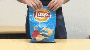Seal your opened chip bags by rolling forwards, folding the sides, and then folding backwards.