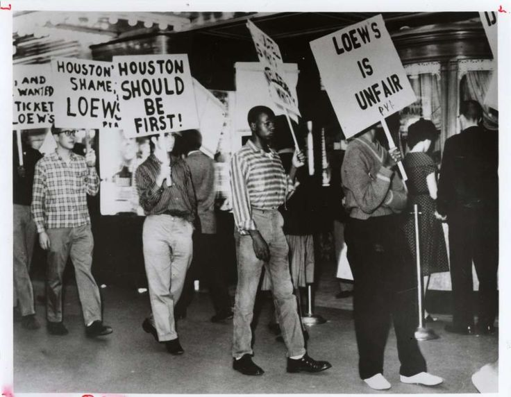 Students picket Loews theaters to desegregate in Houston. Loews movie theater.