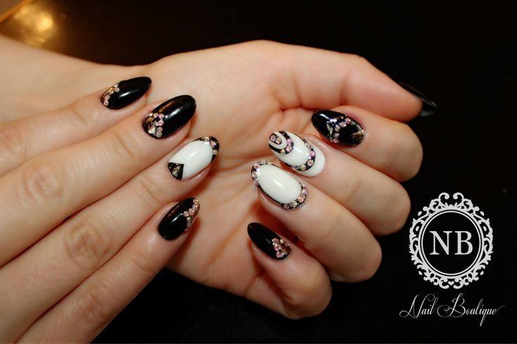 black and white manicure mixed with sparkling crystals