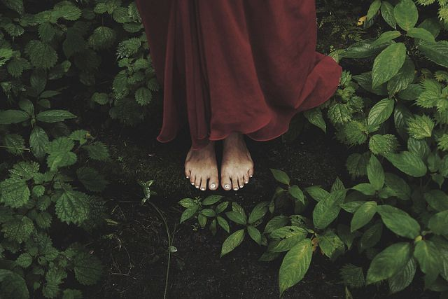 barefoot, in the woods