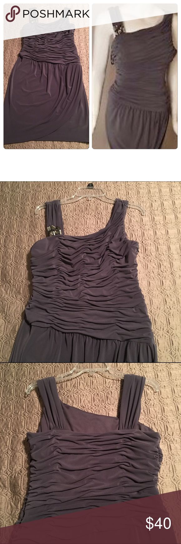 """Jones New York Gray Cocktail Dress Beautiful cocktail dress by Jones New York in charcoal gray with asymmetrical neckline and jewels on one strap. This dress hugs your curves in all the right places while helping minimize your waist and stomach area with the ruched top and draped skirt. Dress is comfortable as it has some stretch to it. Hidden side zipper.  I'm 5'4"""" and this hit at the top of my knee. Only worn once and has since been dry cleaned and hanging in the closet since. ❌ No trades…"""