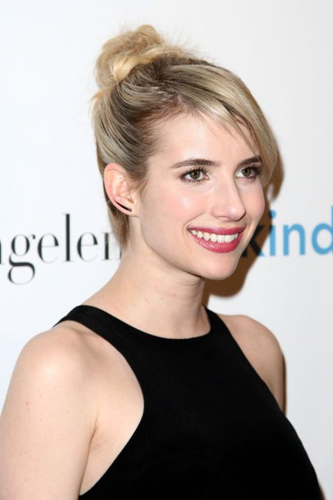 Try Emma Roberts's mid-height chignon next wedding. 14 ways to style your hair for every nuptial on your docket so you never wear the same 'do.