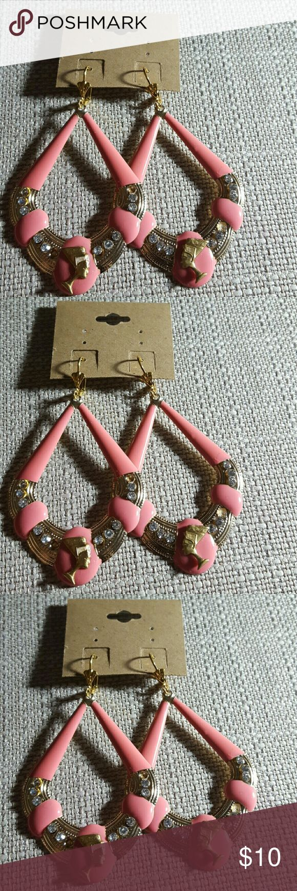 Coral pink queen Nefertiti earrings Coral pink queen Nefertiti earrings.   Gold tone Lever back ear wires Jewelry Earrings