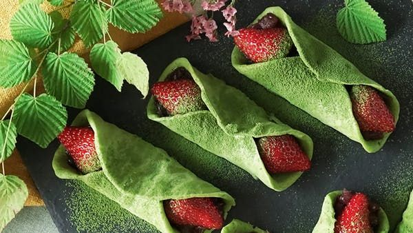 Recipe with video instructions: Enjoy this colorfully sweet confection made with mochi, matcha, red bean, and strawberries. Ingredients: 2 squares mochi, 6 ounces adzuki paste, 12 strawberries, Matcha, Crepe batter:, 1/2 tablespoon matcha , 3/4 cup pancake mix, 1/2 cup milk