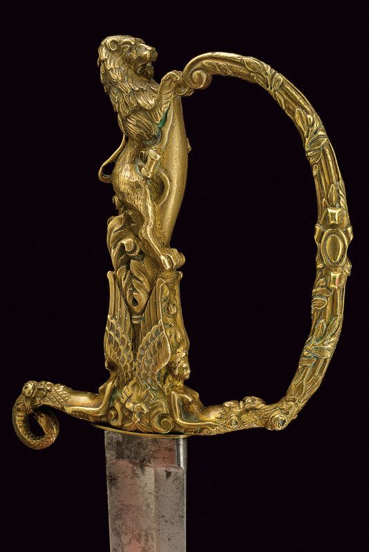 Presentation Sword • Dated: 19th century • Culture: European • Measurements: overall length 80 cm The sword has a curved, single -and false-edged blade, with a fuller on most of the length and a short...