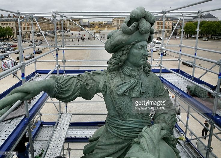 Louis XIV's statue is re-settled at the entrance of the Versailles Palace after a renovation of two years paid by the 'Francaise des Jeux' in Versailles, France on April 27th, 2009 - The bronze equestrian statue of King sunny courtyard of the chateau of V