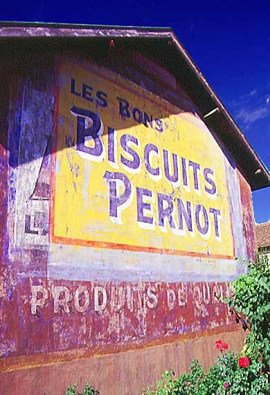 Old painted roadside advertisements: Food - cookies Macon France by Chartier