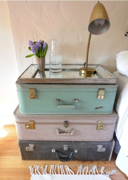 good idea topping the suitcases (or in my case vintage trunk) with a picture frame made into a tea tray.  That makes for easy lift off of surface goods if need to get inside trunk.  Of course I could use baskets etc. too.  Keep looking out for old suitcases!