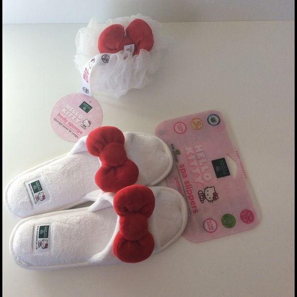 "Hello Kitty Spa Slippers & Body Sponge NWT HP Pamper yourself with this adorable set! The slippers are very soft and cushioned with memory foam ❤️ 10.5"" toe to heel ❤️ Weekend Uniform Host Pick by @chrystella  Earth Therapeutics Shoes Slippers"