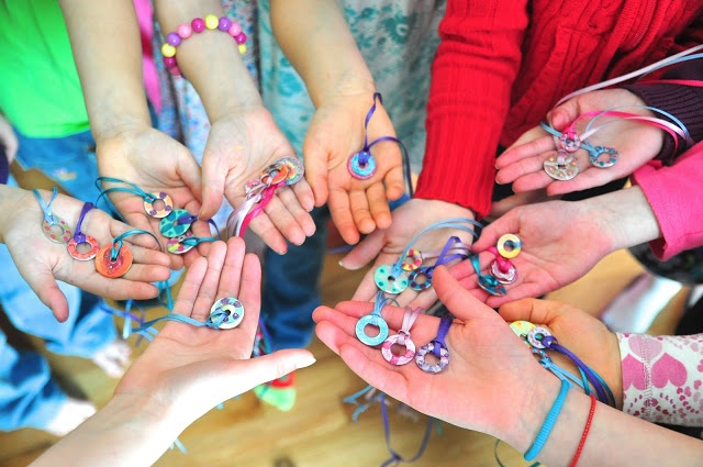 Washer necklaces painted with nail polish.  Good for girls birthday party.  Must try.