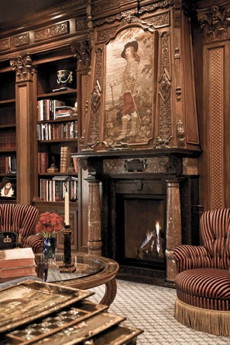 Library fireplace  I love the warmth that the photograph resonates, and I'm not just talking about the fireplace. If you're going to do something in the old-world style, then you need to be able to resonate that warmth of wood (even if you don't have a fireplace).