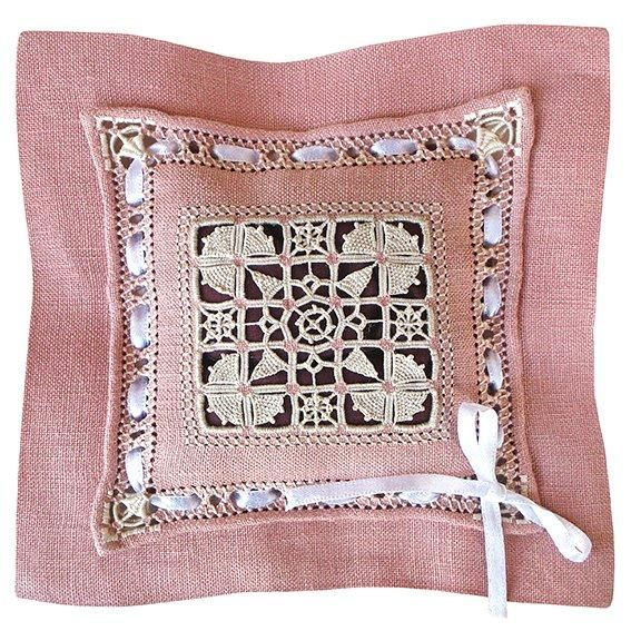 Reticella is an ancient form of Italian needlelace dating from the 15th century. This gorgeous linen fragrance pillow features drawn thread work, needle lace stitches, pea hole hemstitch, counted satin stitch and a rolled hem.