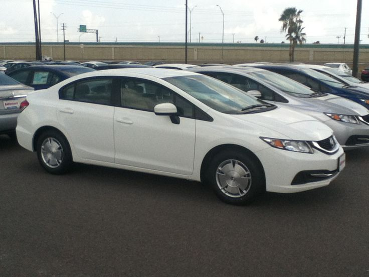 The 2014 Honda Civic HF! It has deck plates underneath the vehicle to reduce wind resistance! It gets 41 mpg on the highway! Here at Gillman Honda in San Benito Texas!