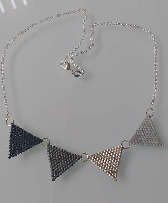 A very pretty bunting necklace, the bunting is made using the Peyote stitch, so every bead is individually threaded together with thread, making a strong interlocking piece of beadwork. The chain is sterling silver and is 16
