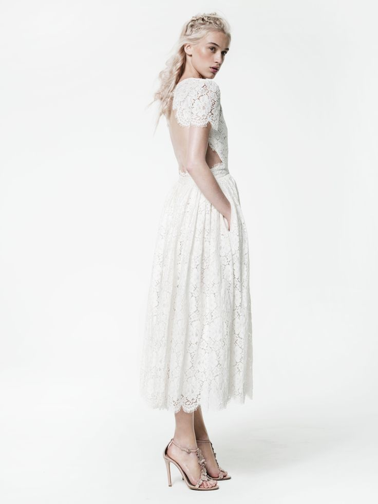 Houghton Prince Dress in French Guipure cotton lace with short sleeves and full skirt with scalloped hem. This perfect garden wedding tea-length dress has an open back and pockets!