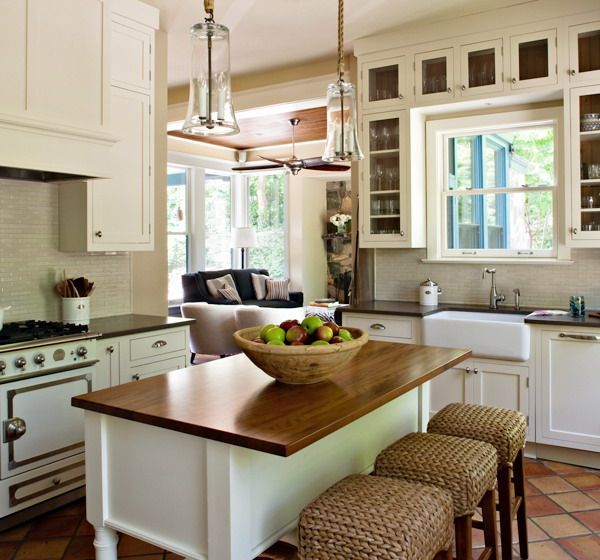 Love the cabinet colour, the tile backsplash the counters, the stools *sigh*