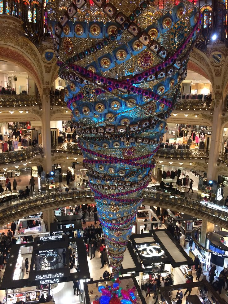 A giant tree hanging upside down at the Galeries Lafayette in Paris. Lafayette is well known for the gorgeous and stunning display to tourists