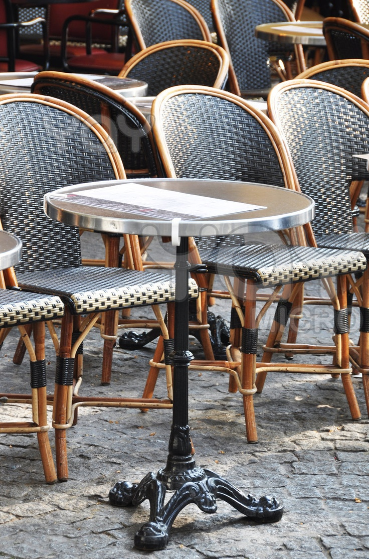 Outdoor cafe in paris with tower in background - The Little Vintage Cafe