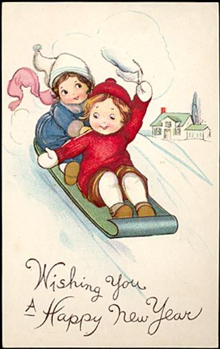 Girls on sled wishing you a Happy New Year.