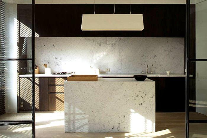 Vincent Van Duysen black and marble kitchen