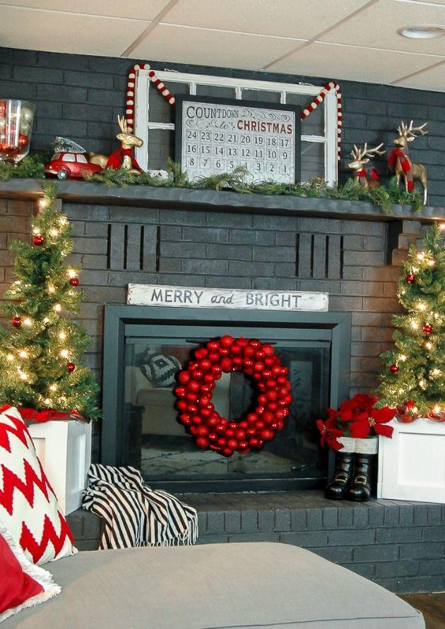A beautifully decorated modern class fireplace mantel. www.littlehouseoffour.com