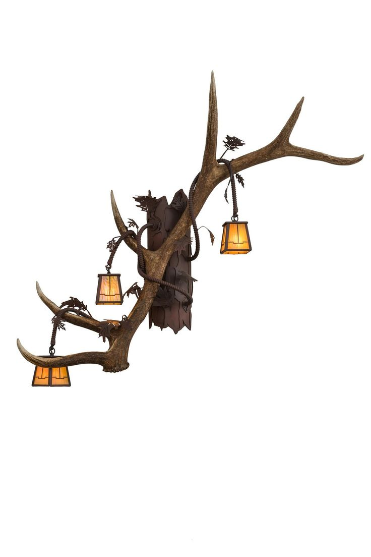 46 Inch W Antlers Elk 3 Lt Wall Sconce. 46 Inch W Antlers Elk 3 Lt Wall Sconce Theme:  RUSTIC LODGE ART GLASS ANIMALS Product Family:  Antlers Elk Product Type:  WALL SCONCES Product Application:  THREE LIGHT Color:  RUST/WROUGHT IRON/BAI Bulb Type: G9 Bulb Quantity:  3 Bulb Wattage:  60 Product Dimensions:  38H x 46W x 17DPackage Dimensions:  NABoxed Weight:  18 lbsDim Weight:  NAOversized Shipping Reference:  TRUCKIMPORTANT NOTE:  Every Meyda Tiffany item is a unique handcrafted...