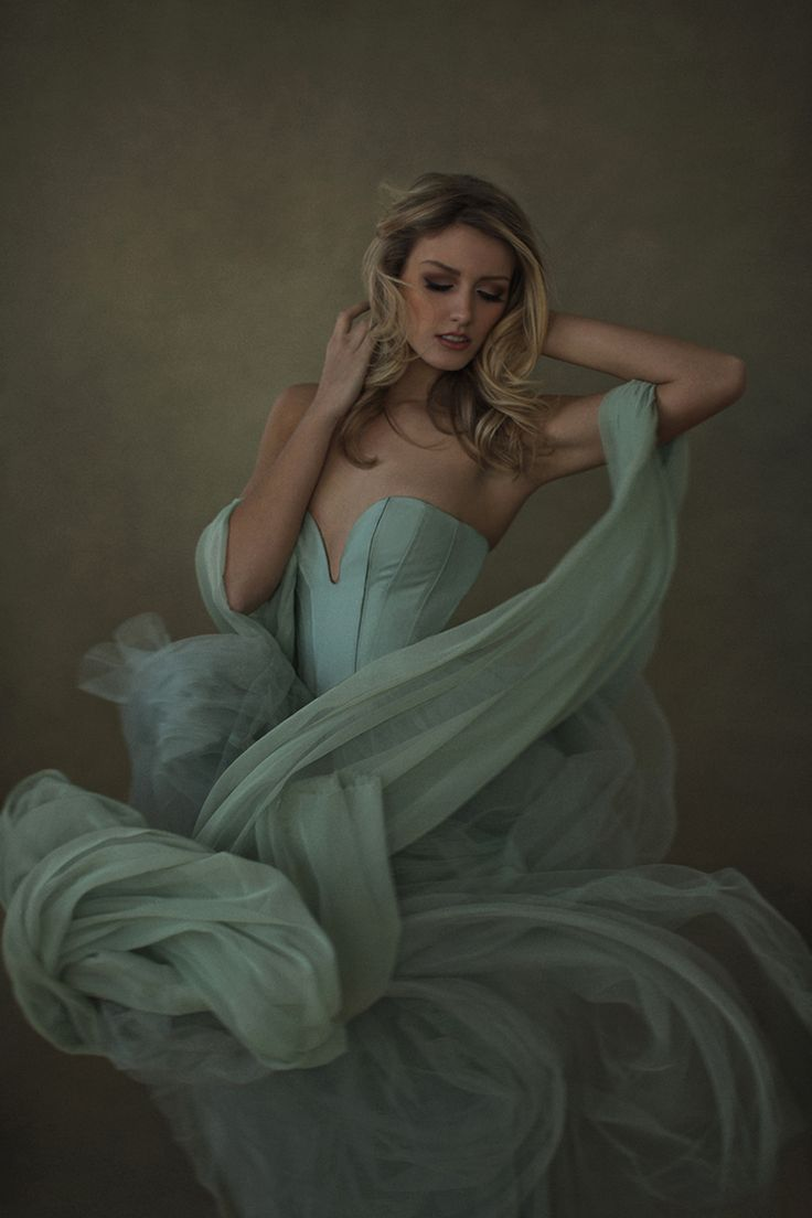 female portrait with dress movement by Sue Bryce