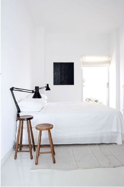 white walls, stools, bed