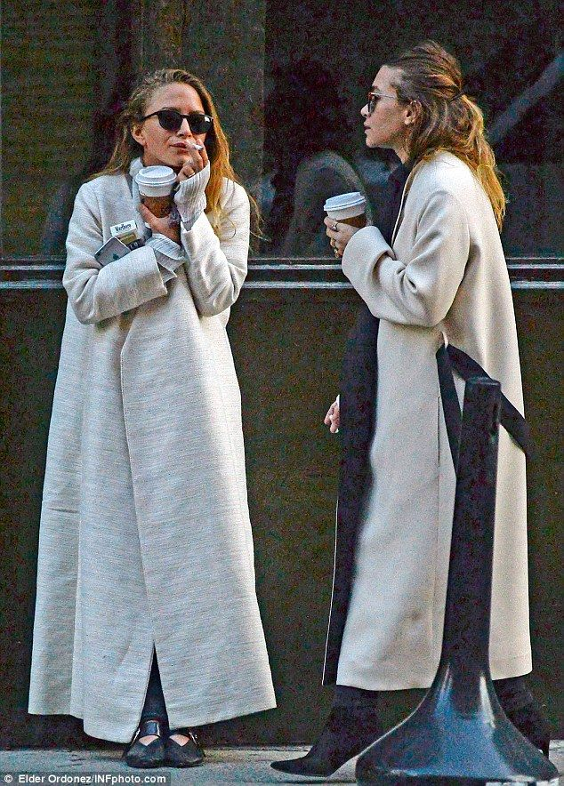 Sister smoke break: In her first sighting since the wedding, Mary-Kate Olsen (L) was spotted smoking a Marlboro Light alongside fraternal twin sister Ashley in Manhattan on Tuesday