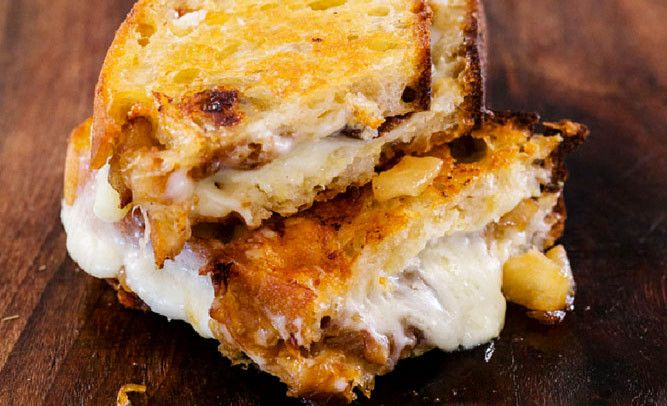 GRILLED CHEESE WITH ASIAN PEAR This delectable sweet-savory sandwich features sauteed onions and pears and two types of cheese. A slathering of Dijon mustard adds a spicy kick.