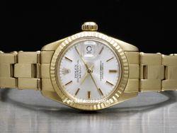 Rolex - Datejust Lady 6901 Cassa: oro giallo - 26 mm Ghiera: oro giallo Vetro: vetroplastica Colore quadrante: argento Bracciale: oyster Chiusura: deployant Movimento: automatico