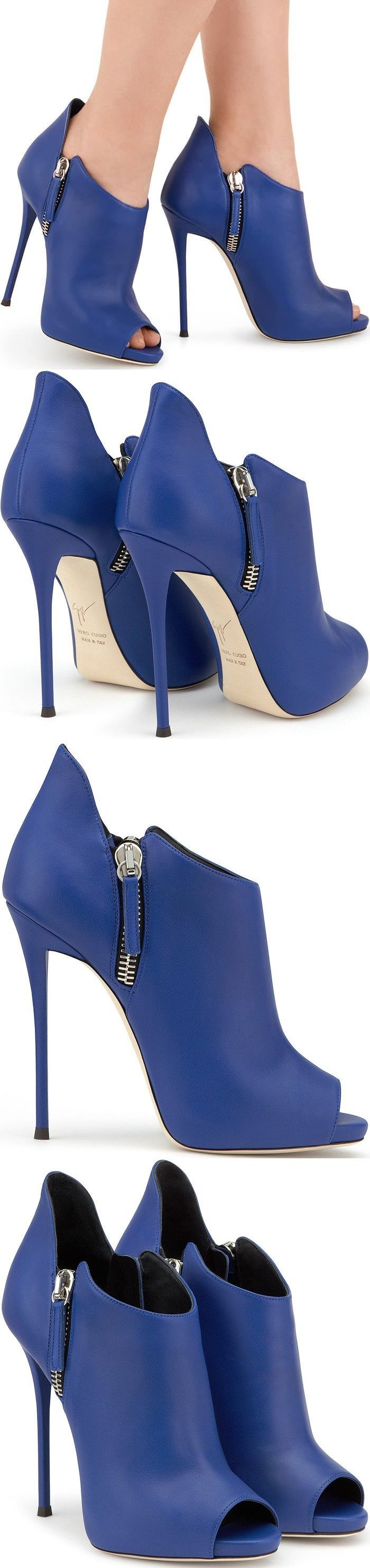 Blue leather 'Malika' booties from Giuseppe Zanotti Design featuring a peep toe, gold-tone hardware, side zip fastenings, a branded insole and a high stiletto heel. #stilettoheelssandals
