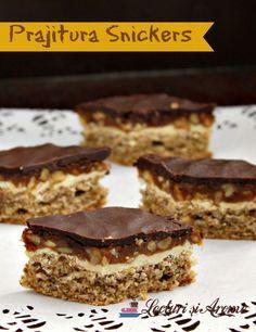 Prajitura Snickers cu nuca si caramel. Prajitura cu mai multe straturi: blat de bezea cu nuca, ciocolata alba, crema caramel cu nuca, ciocolata negra.