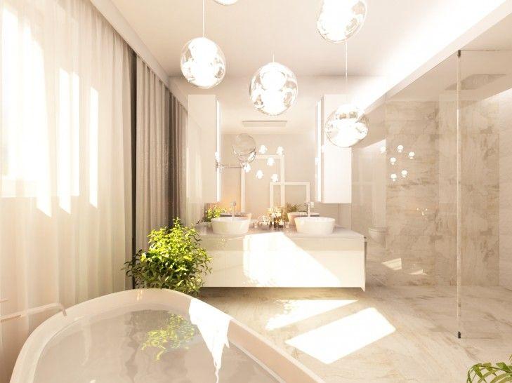 Wystrój wnętrz jasnej łazienki w rezydencji pod Warszawą. Łazienka z wolno stojąca wanną i otwartym prysznicem została wykończona jasnym kamieniem i białymi meblami...