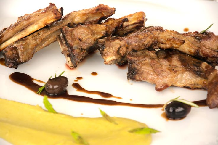 Lamb chops with rosemary sauce, Kalamon olives and caramelized balsamic served with sweet pea purée.