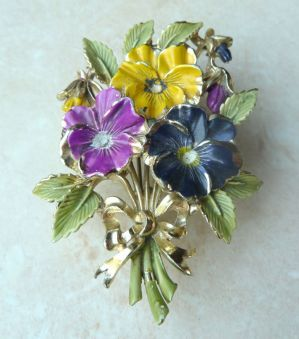 Large pansy flower bouquet birthday brooch by Exquisite.  The brooch is formed from detailed cold painted enamel onto gold tone metal. The brooch forms part of the very collectible Birthday brooch series by Exquisite.