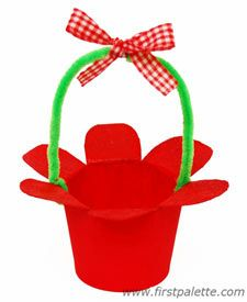 Paper cup craft.  Just add candy or a packet of seeds for a gift.  Could also string these upside down in different colors for kids' room art!