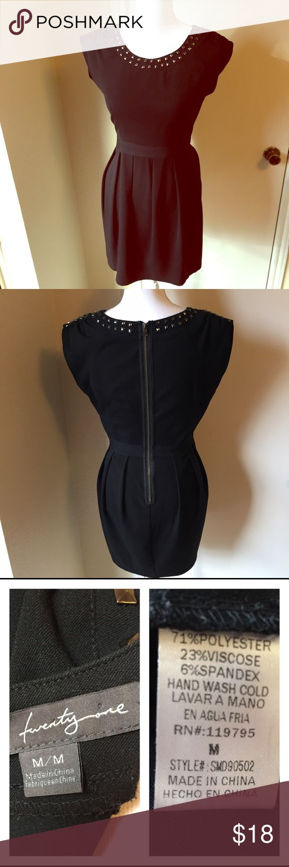 Twenty one BLACK Studded Dress This awesome little black dress features square studs and a long zipper in the back. The pleated skirt and cinched waist are ultra flattering and create a classic silhouette. There are some small pads in the shoulders to give an edgy shape. Would pair well with heels or a choker. *Gently Used Condition* Twenty one Dresses